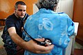 US Navy 110516-F-CF975-075 Lt. Cmdr. Brad Serwer listens to a patient's lungs at the Escuela Don Bosco medical site during Continuing Promise 2011.jpg