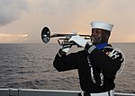 US Navy 110710-N-ZZ999-056 Boatswain's Mate 1st Class Timothy Lumpkin plays the trumpet during a burial at sea ceremony aboard USS Enterprise (CVN.jpg