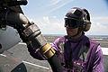 US Navy 110902-N-BT887-249 Aviation Boatswain's Mate (Fuel) Airman Stephen Ricks refuels an F-A-18C Hornet aboard USS John C. Stennis (CVN 74).jpg