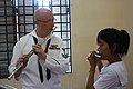 US Navy 111021-N-VC635-830 Musician 2nd Class Anthony Smouse, assigned to the U.S. 7th Fleet Band, Orient Express, teaches a student at the Seconda.jpg