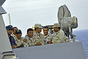 US Navy 111215-N-UZ986-112 Hospital Corpsman 2nd Class Sopheap Nuon, a Cambodian-American translator, and Cambodian Sailors view man overboard oper.jpg