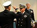 US Navy 120216-N-AQ172-148 Capt. Wesley Guinn salutes Capt. Mark Davis at a change of command ceremony held at Naval Support Activity Naples.jpg