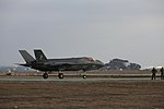 VMFA-121 conducts a vertical landing at Red Beach 151210-M-BG453-062.jpg