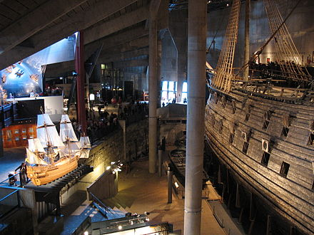 The main hall of the Vasa Museum with a scale model of Vasa as it might have looked on its maiden voyage to the left and the preserved ship itself to the right Vasa Museum interior1.jpg