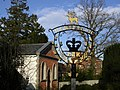 Village sign, with chapel in the background - geograph.org.uk - 651787.jpg