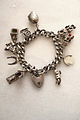 Vintage jewellery uk silver charm bracelet.jpg