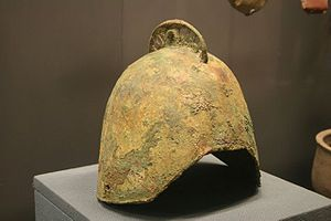 History of Beijing - For several centuries before the unification of China in 221 BC, Beijing was the capital of the State of Yan. Bronze Yan helmet (above), sword-shaped Yan coins (right), and the Gefujia yun (far right), all from the Capital Museum.