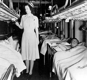 USS Consolation (AH-15) - Navy nurse and patients in Ward C-3, 1950
