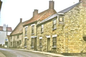 Wellingore - Wellingore High Street in 1973 with the Marquis of Granby in foreground.