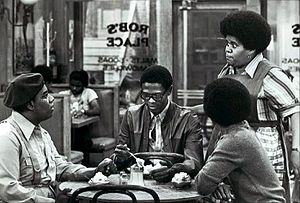 Shirley Hemphill - From TV's What's Happening!! (1977). Seated, L-R: Fred Berry, Ernest Lee Thomas, and Haywood Nelson (back to camera). Standing: Shirley Hemphill.
