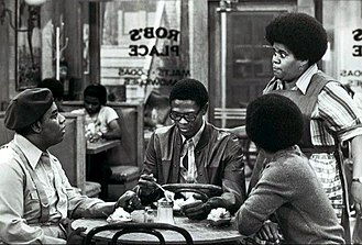 Fred Berry - From TV's What's Happening!! (1977). Seated, L-R: Fred Berry, Ernest Lee Thomas, and Haywood Nelson (back to camera). Standing: Shirley Hemphill.
