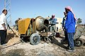 Workers with a cement mixer in Iraq.JPEG