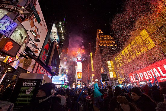 "A crowd gathered in New York City's Times Square at midnight during its annual ""ball drop"". Working New Years Eve Social Media for NBC (9234114888).jpg"