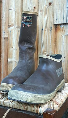 6afd5b2002f Two styles of well-worn Xtratuf boots made with neoprene