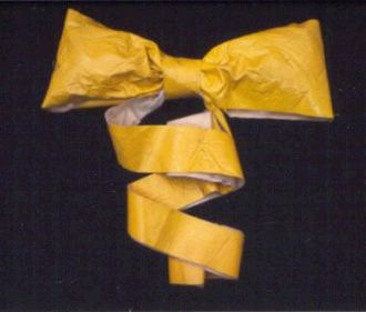 """Yellow ribbon - Yellow ribbon flown in 1979 by Penne Laingen when her husband, US diplomat Bruce was held captive during the Iran hostage crisis; among the first of the modern """"yellow ribbons."""""""