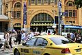Yellow Cab at Flinders Street Station (6760112415).jpg