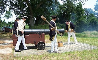Battle of Gwynn's Island - Reenactors dressed in American uniforms load an 18-pounder cannon on a naval carriage.