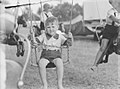 Young boy sitting in a swing on a carousel (AM 79488-1).jpg