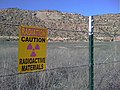 """Caution- Radioactive Materials"" sign at Uravan townsite near San Miguel River, Colorado.jpg"