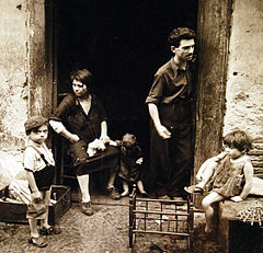 """Children of Naples"". Children play while mother works. August 1944.jpg"