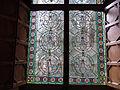 084 Castell de Santa Florentina (Canet de Mar), sala de la terrassa, vitrall de les fúcsies.JPG