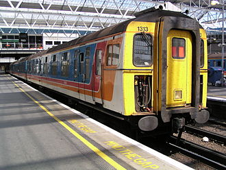 "British Rail Class 421 - Class 421/5, no. 1313, at London Waterloo on 19 July 2003. This is one of 22 ""Greyhound"" units that were operated by South West Trains. This unit has since been withdrawn and scrapped."