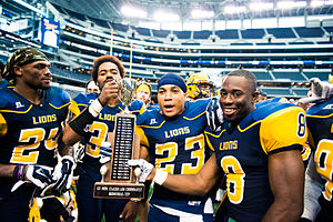 Texas A&M–Commerce Lions - TAMUC football players pose with the Chennault Cup in 2014 after defeating TAMUK in the Lone Star Conference Football Festival