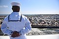 180411-N-NQ487-222 - PO3 Anthony White mans the rails aboard the aircraft carrier USS Harry S. Truman.jpg