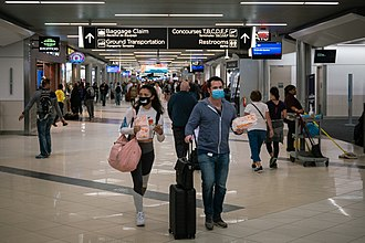 Passengers wearing facemasks at Hartsfield-Jackson Atlanta International Airport 2020-03-06 -- Coronavirus - Flyers at Hartsfield-Jackson Atlanta International Airport wearing facemasks.jpg