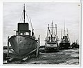 3-65. Homer - Dry-docked small boats on spit (24846846081).jpg