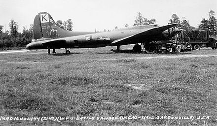 Battle damaged Boeing B-17G-30-BO Fortress Serial 42-31902 of the 447th Bomb Group at Rattlesden after a mission whose operational objective was a jet engine plant in Stuttgart, Germany, July 1944. 447bg-b17-2.jpg