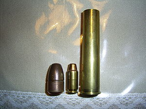 .700 Nitro Express - .700 Nitro Express bullet and case with .45 ACP cartridge (centre) for comparison