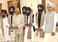 A.P.J. Abdul Kalam and the Prime Minister, Dr. Manmohan Singh with the Bhai Saheb Gurkirat Singh, Hazoori Ragi, Sri Harmandir Sahib, Amritsar, after attending a Gurbani recital.jpg