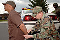 A U.S. Air Force Airman 1st Class from the 305th Air Mobility Wing, McGuire Air Force Base, N. J., handcuffs a released hostage played by Senior Airman Jonathan Trupe, 6th Airlift Squadron, during Crisis Look 060517-F-RU783-013.jpg