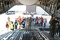 A U.S. Air Force medical officer, center, with the New York Air National Guard briefs volunteer simulated victims in the cargo bay of a C-17 Globemaster III aircraft assigned to the 105th Airlift Wing during 130601-Z-GJ424-006.jpg
