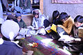 A group of Afghan boys gather in a bazaar shop in Ali Kheyl to follow along during a weekly literacy program aired over the radio in Jaji district, Paktia province, Afghanistan, Dec. 26, 2011 111226-A-VT689-008.jpg