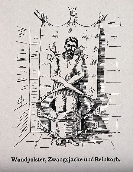 A patient in a strait-jacket and barrel contraption, 1908 A mentally ill patient in a strait-jacket attached to the wa Wellcome V0016643ER.jpg