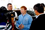 Adam Putnam answers questions during a survey of recent hurricane damage.jpg