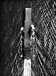 Aerial view of USS Intrepid (CV-11) underway at sea, in 1945.jpg