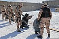 Afghan National Police officers prepare to engage their targets under the guidance of Czech military police instructors during a small arms practice range at Forward Operating Base Shank, Logar province 120222-A-RR514-055.jpg
