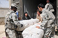 Afghan police and US Soldiers partner to provide aid to flood victims DVIDS322776.jpg