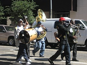 Rebirth Brass Band - Two members of the Rebirth Brass Band with other musicians playing for a second-line parade in New Orleans' Central Business District, 2007