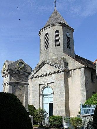 Ahun - The war memorial and the church of Saint-Sylvain, in Ahun
