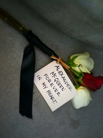 A dedication by a fan at an Alexander McQueen store after McQueen's death Alexander McQueen Shrine.jpg