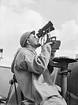An Anti-Aircraft Control Spotter at his observation post on board an anti-aircraft ship in 1940. D878.jpg