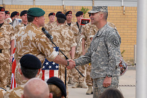Michael L. Oates - British Major General Andy Salmon (left), Multi-National Division-Southeast commander, and Major General Michael L. Oates (right), MND-South commander, shake hands during the transfer of responsibility ceremony in Basra, Iraq