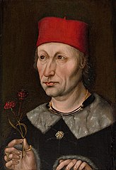 Man in a Red Cap Holding a Carnation