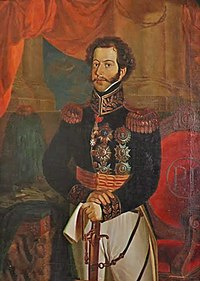 Painted half-length portrait showing a young man with curly hair and mustachios who is wearing an elaborate embroidered military tunic with gold epaulets and medals