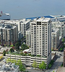 Apartment building in Belltown with Elliot Bay in background - Seattle.JPG