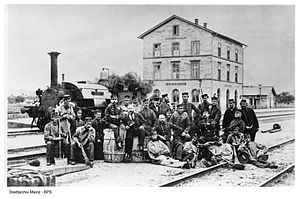 """Hessian Ludwig Railway - Bischofsheim Junction with shunting locomotive """"Landskron"""" and station staff, 1867"""